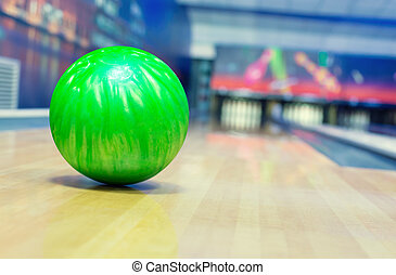 Bowling alley - Ball on bowling alley against ten pins