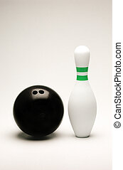 Bowling ball and pin isolated on white