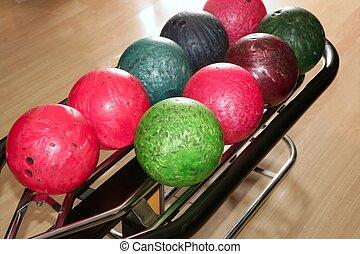Bowling balls red green closeup row detail