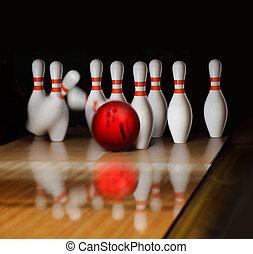 bowling - orange ball does strike on tenpin bowling in...