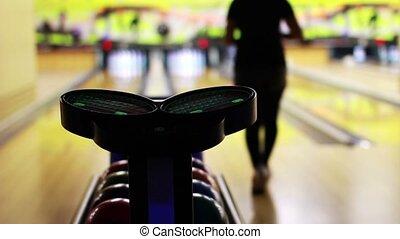 bowling playing - playing bowling in a bowling saloon