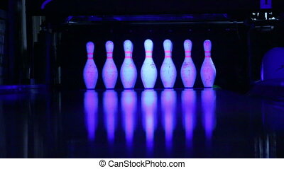 Bowling. - Rolling bowling ball striking the pins on the...