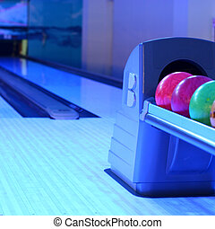 bowling - few colored bowling balls in a row