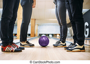 Bowling team, feet in house shoes and ball on lane - Bowling...