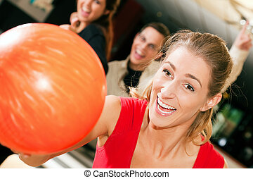 Bowling with friends - Group of four friends in a bowling...