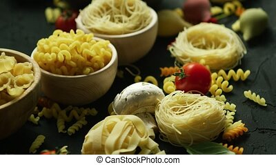 Bowls full of macaroni and tomatoes - White bowls with...