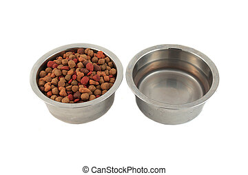 Dog bowls full of food bits and water on a white background