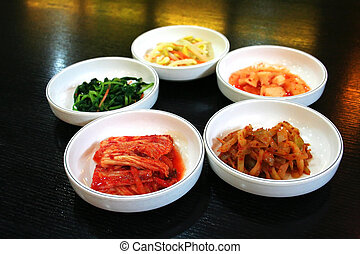 Bowls of Kimchi traditional Korean spicy vegetable pickles