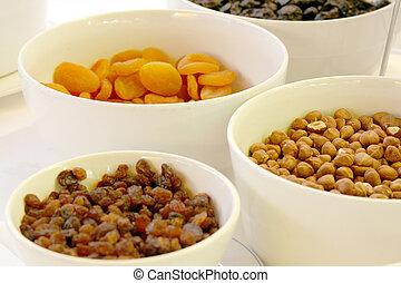bowls of nuts and rasins