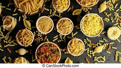 Bowls of pasta and macaroni in assortment - Top view of...