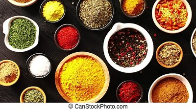 Bowls with colorful spices - From above view of many bowls...