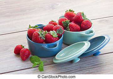 bowls with strawberry on a table