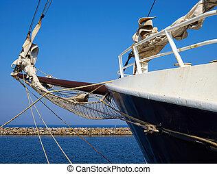 Bowsprit and gathered sail of a large sailing ship