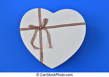 box for gifts in shape of heart on blue background