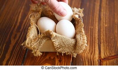 box full of burlap with eggs