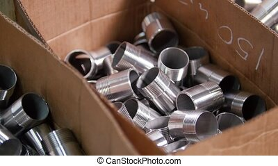 Box full of round metal pieces. Overview