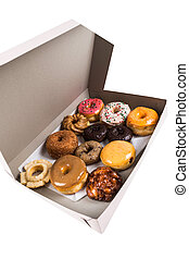 Box of assorted donuts isolated on a white background