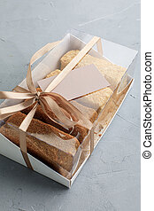 box of cakes with business cards. assortment for a pastry shop