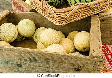 Box of cantalope melons at the market
