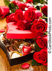 box of chocolate truffles with red roses - Heart shaped box...