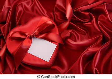 Box of chocolate with red ribbon