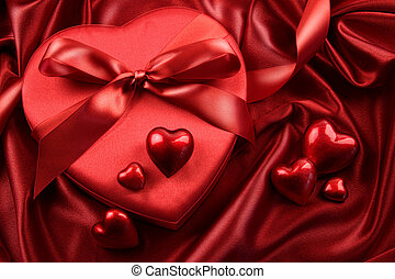 Box of chocolates with ribbons anf hearts