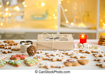 Box of cookies, gingerbread cookies of different shapes, white d