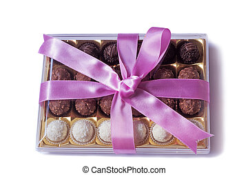 Box of delicious chocolates, nicely decorated and tied with a ribbon gift for any holiday or celebration. Presented on a white background
