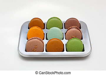 Nine Colorful French Macarons in a Tray