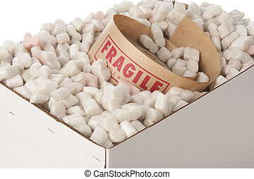 box of packing peanuts with roll of fragile tape inside -...