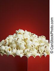 Box of popcorn and red background