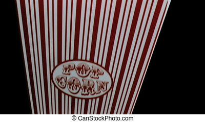 Box of popcorn in super slow motion falling