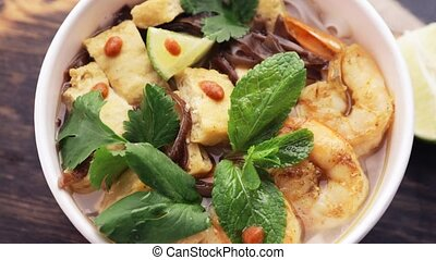 box of Vietnamese food - Asian rice noodles with shrimp and...