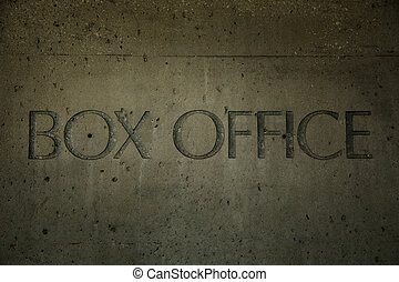 Box office engraved into cement on a wall