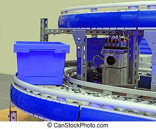 box on the conveyor - blue box moves on a roller on the...