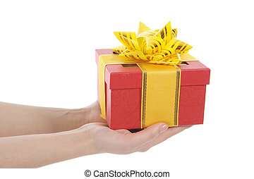 Box with a gift in the hands of women. Isolated on white background