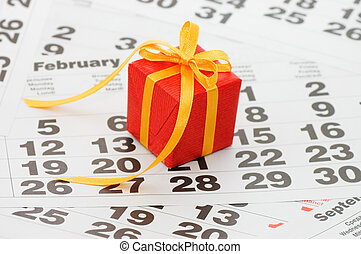 Box with a gift on calendar sheet - - Valentines day