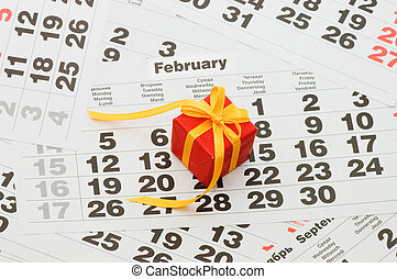 Box with a gift on calendar sheet - Valentines day