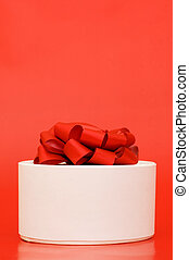 Box with a gift on the red