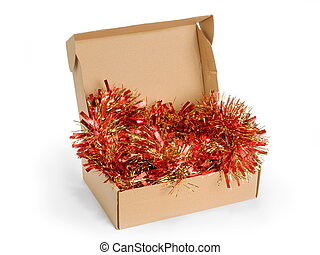 Box with christmas tinsel isolated