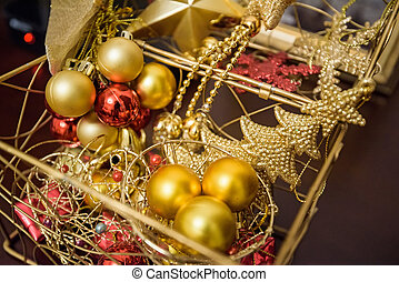 Box with colorful Christmas decorations close up