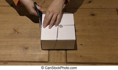 Box with cupcakes. The process of opening the box.