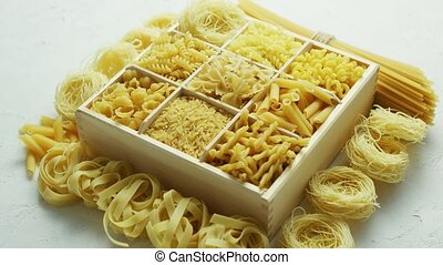 Box with great assortment of pasta - Wooden box filled with...