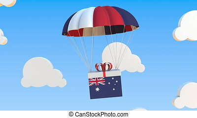 Box with national flag of Australia falls with a parachute. Loopable conceptual 3D animation