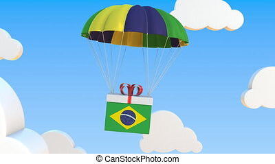 Box with national flag of Brazil falls with a parachute. Loopable conceptual 3D animation