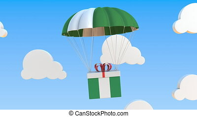 Box with national flag of Nigeria falls with a parachute. Loopable conceptual 3D animation