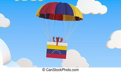 Box with national flag of Venezuela falls with a parachute. Loopable conceptual 3D animation