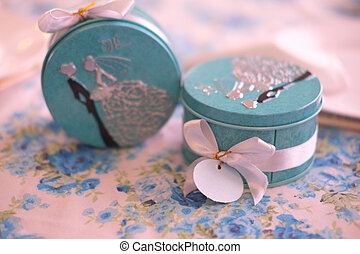 box with paper tags on table gift from wedding ceremony