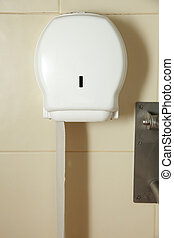 Box with toilet paper on the wall in bathroom