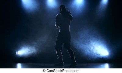Boxer concentrates attention before the fight. Silhouette